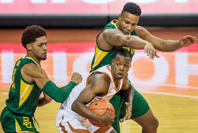 Texas guard Andrew Jones looks to pass the ball while being defended by Baylor guards MaCio Teague and Mark Vital during the second half of the Bears' win on Tuesday.