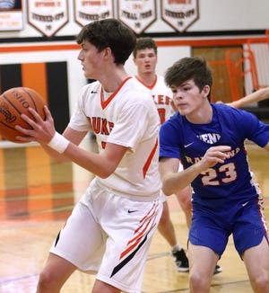 Marlington's Ben Yoder, left, and Ravenna's Riley Sauer, right, during action at Marlington High School Tuesday, February 2, 2021.