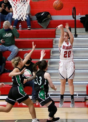 Loudonville's Shalen Guilliams (20) connects on one of her six 3-pointers against Clear Fork Tuesday at Loudonville High School.