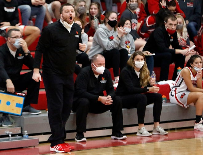 Loudonville girls basketball coach Tyler Bates shouts instructions to his players during a game against Clear Fork last season. [Tom E. Puskar/Times-Gazette.com]