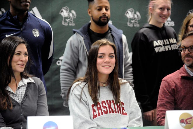 Aquinas senior Reagan Gibbs, center, signed her national letter of intent to play soccer at Erskine University on Wednesday, Feb. 3, 2021.