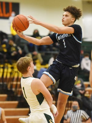 Central Valley's Jayvin Thompson shoots over Blackhawk's Sean McCusker during Tuesday night's game at Blackhawk. The Warriors took home the win 60-46.