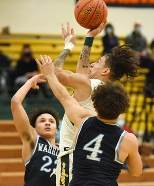 Blackhawk's Lorenzo Jenkins shoots over Central Valley's Andre Vaccich and Carson Douglas during a game earlier this season. The WPIAL denied Jenkins' request for postseason eligibility on Monday. Jenkins transferred to Blackhawk from Fox Chapel in January.