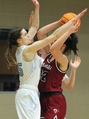 Bartlesville High forward Ragen Hodge, left, pressures the shot of an Owasso Lady Rams' player during varsity girls basketball action Tuesday in Bartlesville.