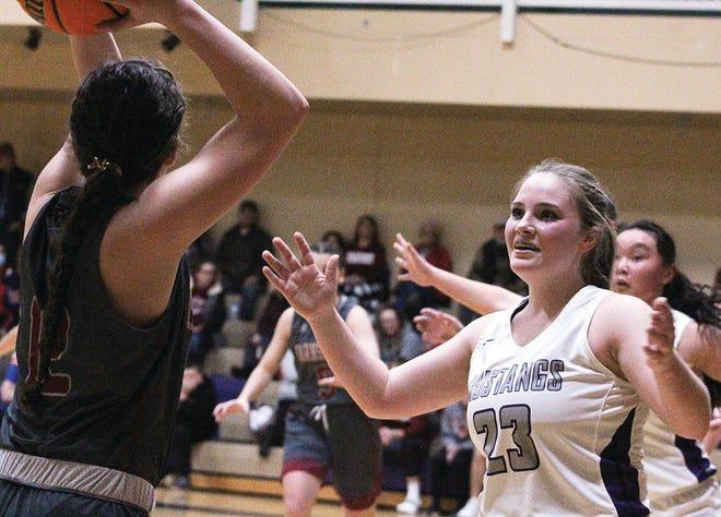 Wesleyan Christian School's Rachel Hopkins, right, scored in double-figures against Prue.