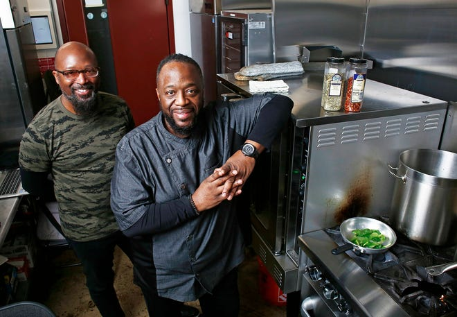 Chef Will Hightower, right, owns Soul 2 Go, which is part of a trend of businesses operating carryout-only from ghost or cloud kitchens. He and his brother, Kevin Hightower, left, are business partners.