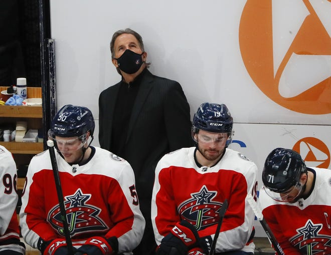 Blue Jackets coach John Tortorella glances at the scoreboard during the second period of his team's 6-3 loss to Dallas on Tuesday.