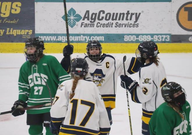 Catherine Tiedemann (center) scored the game-winning goal in Crookston's 1-0 win over East Grand Forks on Feb. 2, the Pirates' first win over the Green Wave since 2012.