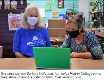 Barbara Hollerand, business liaison for the City of Clermont, helps Plaster Cottage owner Mary Anne Sherrod, right, register at www.RiseClermont.com.