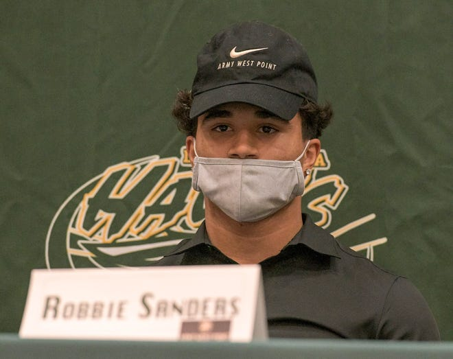 Lake Minneola quarterback Robbie Sanders waits for the start of a signing ceremony Wednesday at Lake Minneola High School in Minneola. Sanders will be an Army cadet at The United States Military Academy at West Point, New York. [PAUL RYAN / CORRESPONDENT]
