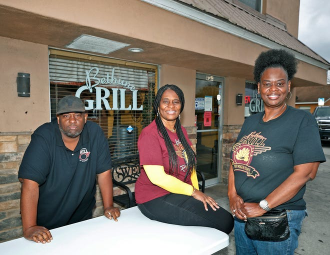 Bethune Grill owner Shannon Hines, left, along with his sisters Rosemary Jenkins and Karen Hankerson at Bethune Grill in Daytona Beach, Feb. 2.
