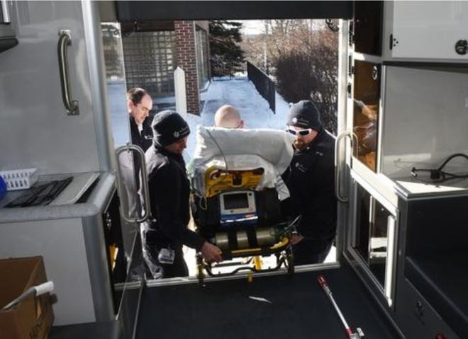 In this file photo, paramedic student Cody Nason simulates being a patient as Frisbie Medical Paramedics Dave Emmons, left, and Mike Dow lift him into an ambulance at Frisbie Memorial Hospital in Rochester.
