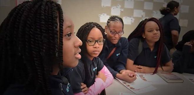 Amber Ferrell (left) talks at a Girls Inc. of Jacksonville gathering in 2017.