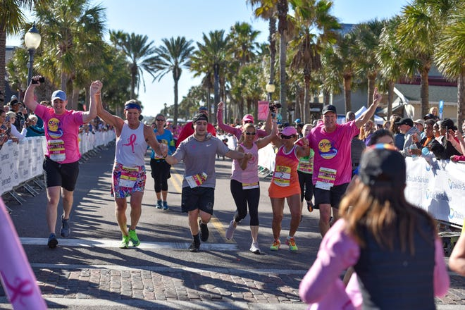 Donna Deegan (third from right), founder of The Donna Foundation and husband, Tim Deegan (second from left), cross the finish line during the 2020 Donna Marathon. This year's events take on a virtual format beginning Feb. 6.