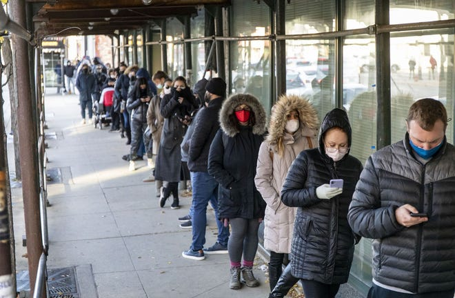 Voters wait in line outside the Goldblatts Building in West Town on Nov. 2, 2020, the last day of early voting in Chicago. Some said theY'd waited over two hours to vote.