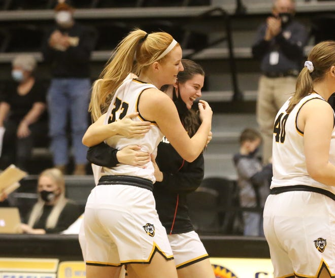 Fort Hays State's Olivia Hollenbeck is hugged by teammate Carly Thompson after Hollenbeck came up big down the stretch of FHSU's 68-60 win over Nebraska-Kearney on Saturday at Gross Memorial Coliseum.