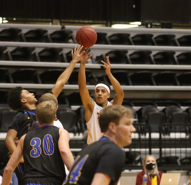 FHSU's Jordan Pumphrey attempts a 3-pointer against UNK on Saturday. Pumphrey hits seven 3s in the game.