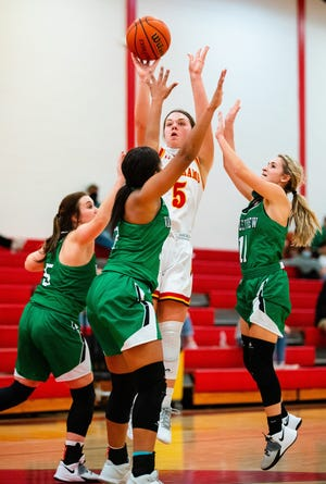 S&S' Brenna Howard shoots over three defenders during the Lady Rams' victory against Valley View in Sadler.