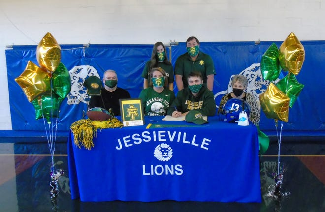Charles Davis, Jessieville High School senior football player, signs his letter of intent with Arkansas Tech University. From left front, Corbett Sutton (grandfather); Sandy Davis (mother); Charles Davis; Brandi Sutton (grandmother). Back row, Chloe Davis (sister) and Robbie Davis (father).