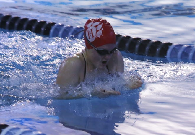 Hendersonville's Mary Ashley swims in the butterfly event at a meet last season at the Henderson County YMCA.