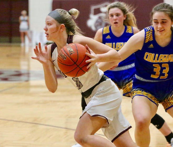 Buhler's Paige McDowell (3) drives to the basket past Wichita Collegiate's Avery Elofsson (33) during their game Tuesday night in Buhler. Wichita Collegiate defeated Buhler 43-33.