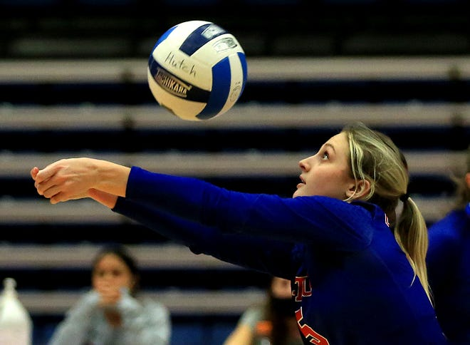Hutchinson's Chloe Price (5) passes the ball during their game against Barton Tuesday evening at the Sports Arena. Hutchinson lost to Barton 18-25, 15-25, 25-22, 27-29.