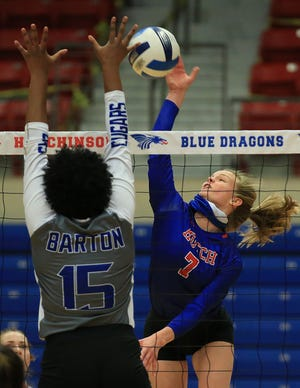 Hutchinson's Shadee Briggs (7) spikes the ball against Barton's Maria Santos (15) Tuesday evening at the Sports Arena. Hutchinson lost to Barton 18-25, 15-25, 25-22, 27-29. To see more photos go to www.hutchnews.com/sports