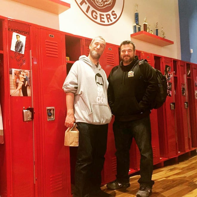 """Dustin Diamond and Dan Block stand in a representation of the """"Saved by the Bell"""" set in California. Diamond, who played Samuel """"Screech"""" Powers on that TV show, formed an unlikely friendship with Block, who owns an insurance business in Peoria."""