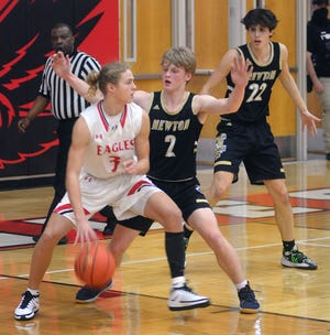 Newton junior Dylan Petz guards Maize sophomore Avery Johnson during play Tuesday in Maize.