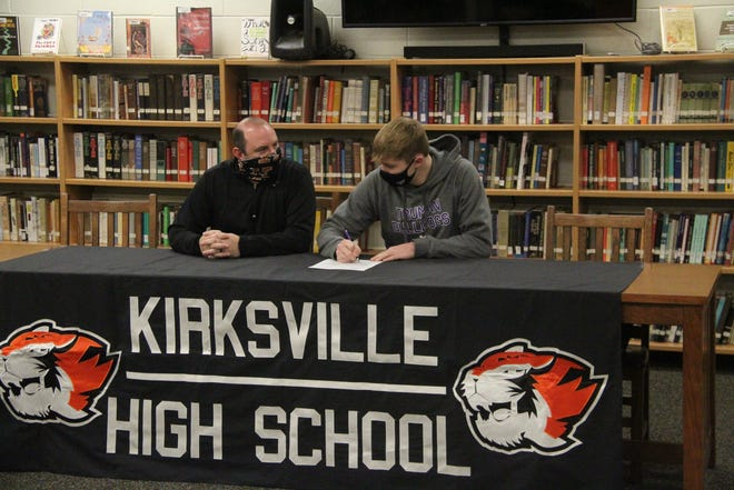 Noah Copeland, right, talks with Kirksville football coach Kevin Krietemeyer as he signs his letter of intent Wednesday to play football at Truman.