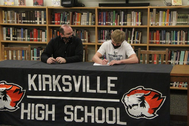 Kirksville senior Logan Blickhan, right, signs his letter of intent to play football at Westminster College in Fulton.