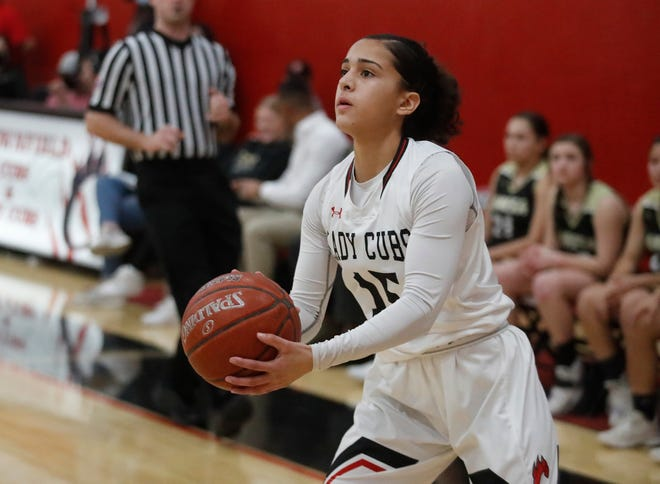Brownfield's Gabi Fields (15) lines up a shot during the Lady Cubs' 81-19 home victory Tuesday against Lamesa. Brownfield clinched a share of the District 3-3A championship. (Mark Rogers/For A-J Media)