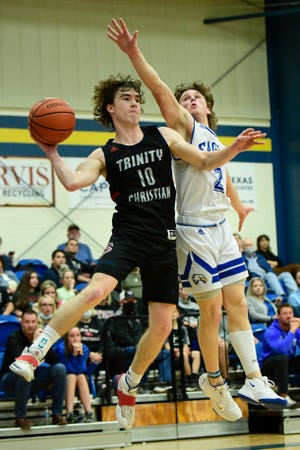 Trinity's Ethan Duncan (10) passes the ball during a TAPPS District 1-4A game against Lubbock Christian on Feb. 2 at Lubbock Christian High School. [Justin Rex/For A-J Media]