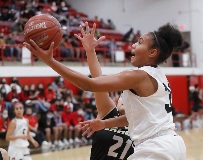Brownfield's Tia Johnson (31) goes up for a shot defended by Lamesa's Clariss Moreno (21) in the first half of a District 3-3A game Tuesday in Brownfield.