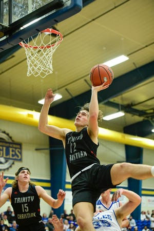 Trinity's Tate Truby (12) shoots the ball during a game against Lubbock Christian on Tuesday, Feb. 2, 2021, in Lubbock Christian High School in Lubbock, Texas. [Justin Rex/For A-J Media]