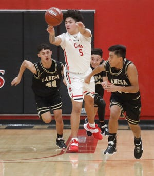Brownfield's Pete Marroquin (5) passes down court in the first half of District 3-3A game Feb. 2 against Lamesa in Brownfield. [Mark Rogers/For A-J Media]