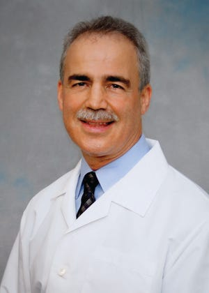 Charles Canver, M.D., FACS, a cardiovascular-thoracic surgeon at Lake Regional.