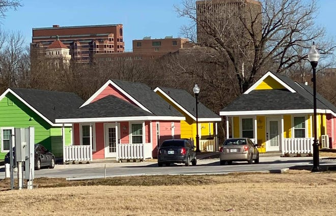"""The McPherson Housing Coalition is planning """"Oak Harbor Cottages,"""" a settlement of 10 tiny homes similar to a  project in Bartlesville, Okla. The Oak Harbor Cottages will also have a playground and a basement under the manager's house for meetings and a storm shelter."""