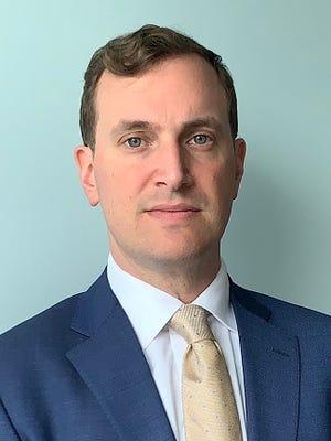 Dr. Justin Slavin