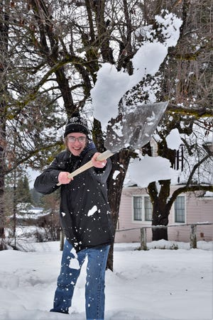 McCloud's Jaden Quiring capitalizes on the snow, offering to shovel his neighbors. But he said he'll take what they can afford to give, and has coordinated his friends to help with the big chore of digging out after a big storm, like last week's whammy.   Photo by Shareen Strauss