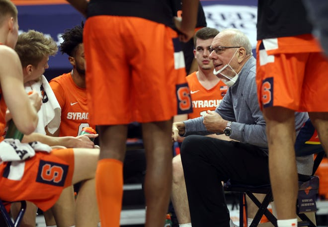 Syracuse head coach Jim Boeheim talks with his players during a recent game.