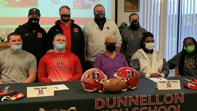 "Dunnellon's Colby Smith and Douglas ""DJ"" Fowler signed to play football at Dodge City in Kansas."