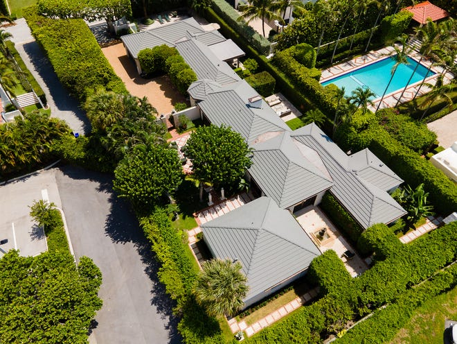 Elzbieta and Thomas D'Agostino Sr. just parted with their longtime Palm Beach home on a double lot at 118 Seaview Ave. for a recorded $8.75 million.