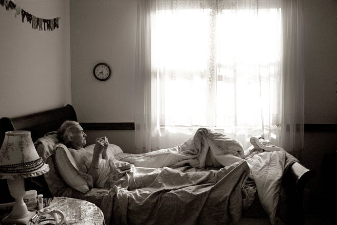"Steber's mother Madje enjoying breakfast in bed at Midtown Manor, an assisted living facility in Hollywood. The photo is part of Steber's exhibit at the Palm Beach Photographic Centre titled ""From the Heart,"" which will be view Tuesday to April 30."