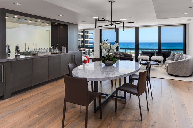 The dining area of this renovated Beach Point condominium has an ocean view, thanks to its position by the main living area.