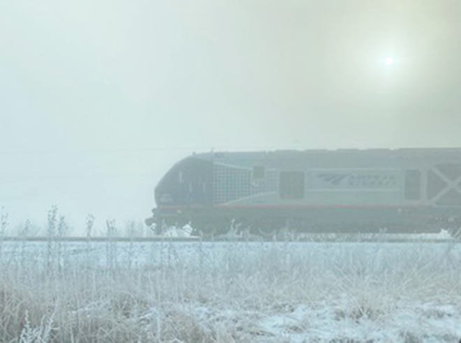 A train makes its way to Pontiac through the fog that covered Livingston County Wednesday morning.