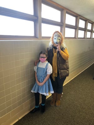 Haviland Grade School student Evie Stokes and 4th grade teacher Katrina Rinker pose during spirit week at Haviland Grade School, dressed up as characters from a Kansas-based show, Wizard of Oz.
