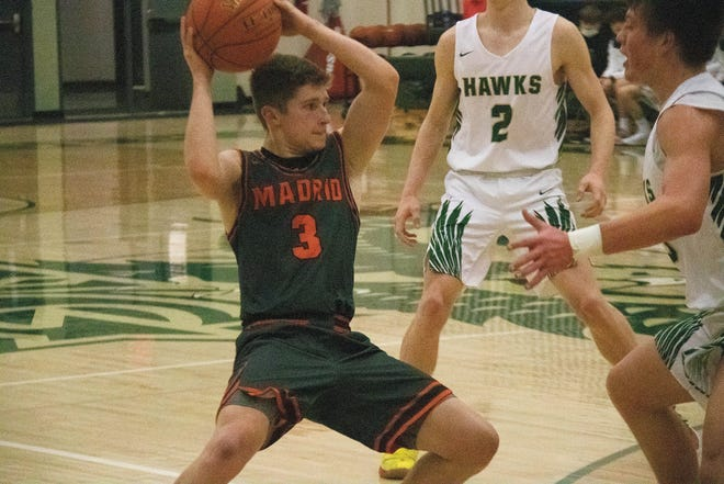 Carson Havlik looks to move the ball against a Woodward-Granger defender on Tuesday, Feb. 2 in Woodward.