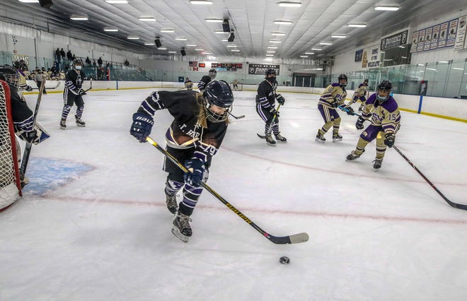Mt. Hope/East Providence Co-op's Riley Feeney clears the puck against St. Ray's/PCD/Wheeler Co-op at the Lynch Rink in Pawtucket earlier this season.