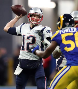 Tom Brady, shown in action in Super Bowl LIII against the Rams in 2019, on Sunday will become only the fourth NFL quarterback to start  a Super Bowl for two different teams.
